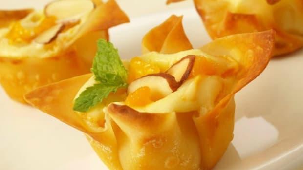 Mini Mango Amaretto Cheesecakes