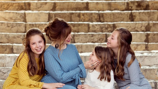 Jamie Geller and Girls Sit on the Stairs in Yemin Moshe