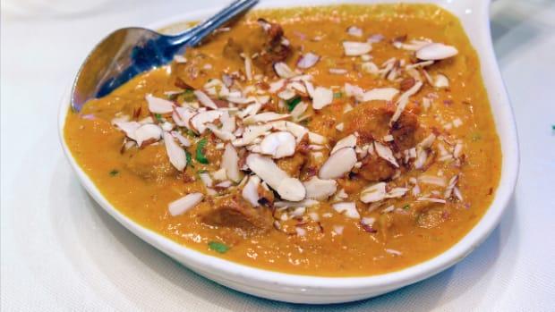 Beef Curry Korma with Sliced Almonds Closeup