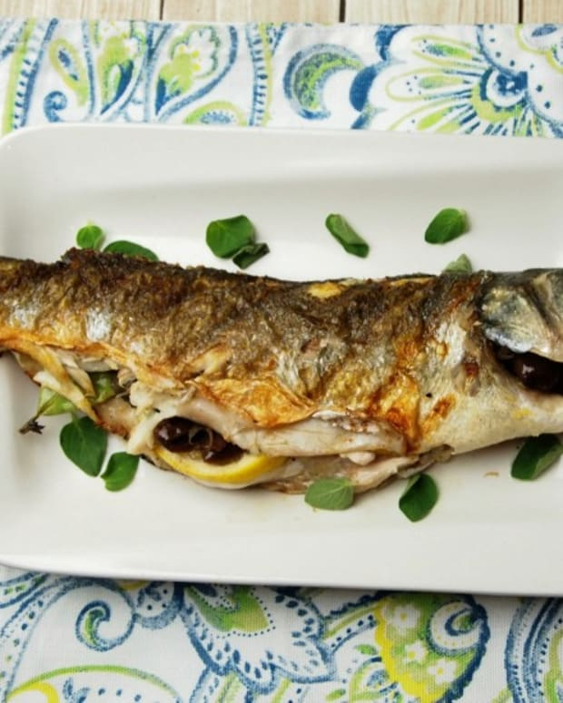 whole grilled branzino with olives and lemon