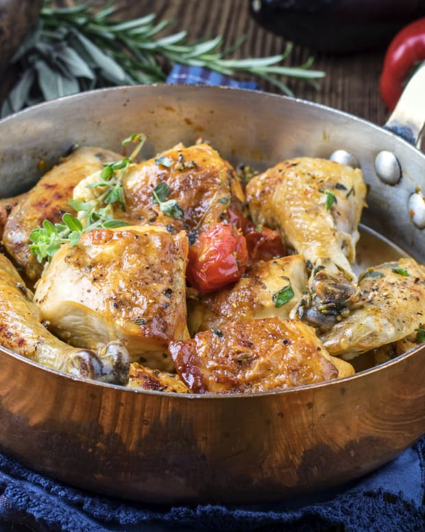 Chicken in the pot with fresh herbs