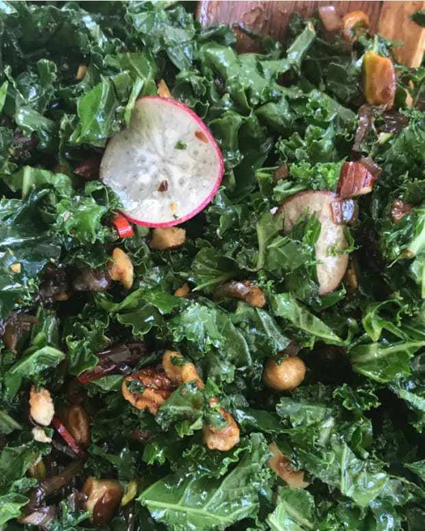 Kale Salad with Warm Shallot Vinaigrette and Crunchy Nut Topping
