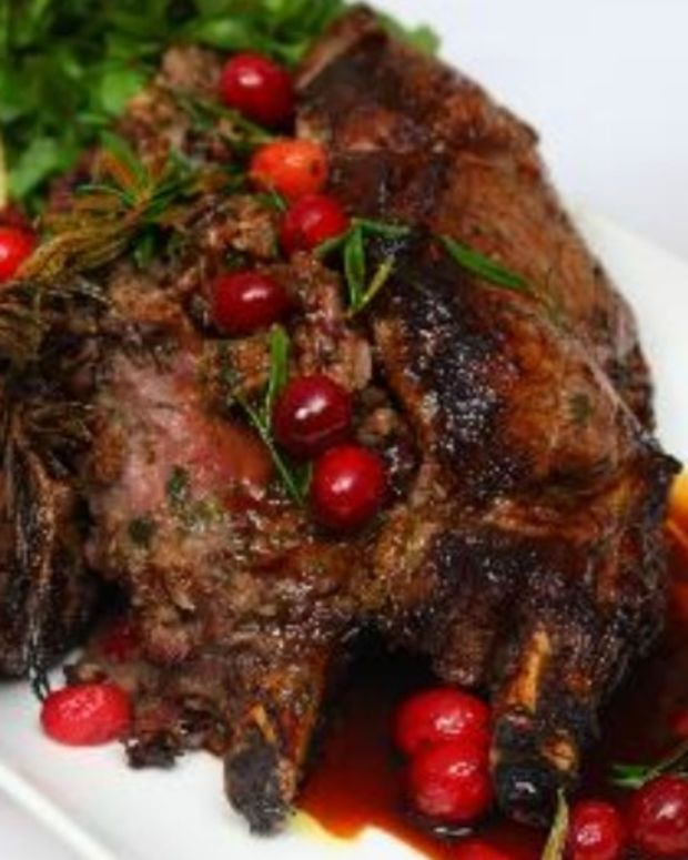 Roasted veal rib eye stuffed with cranberries, dates, sage & rosemary