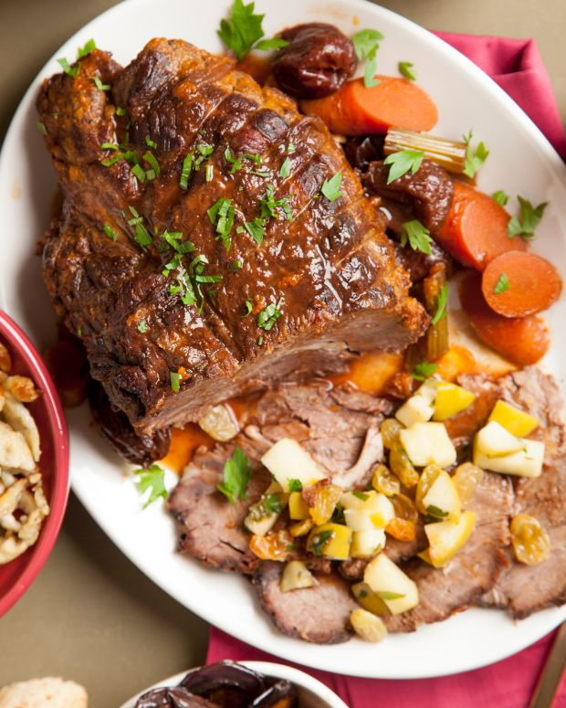 Braised pot roast with prunes, ancho chilis, golden raisins and roasted apples