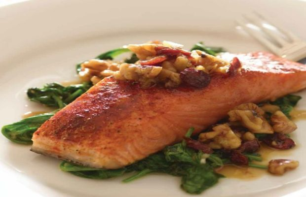 cranberry walnut salmon on a bed of spinach