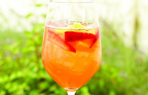 Sangria with strawberry tequila, fresh pineapple juice, and dry rose wine
