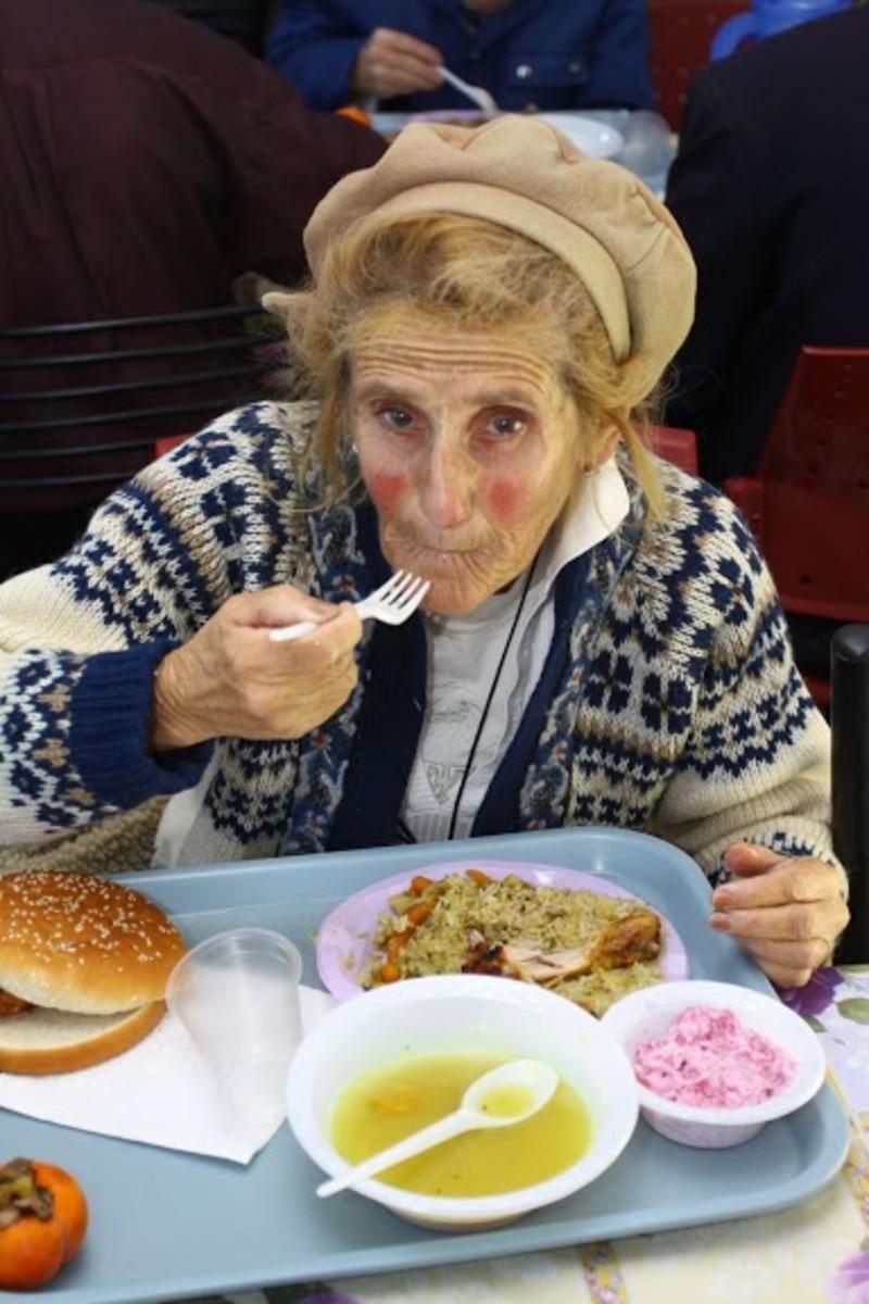 Elderly woman eating