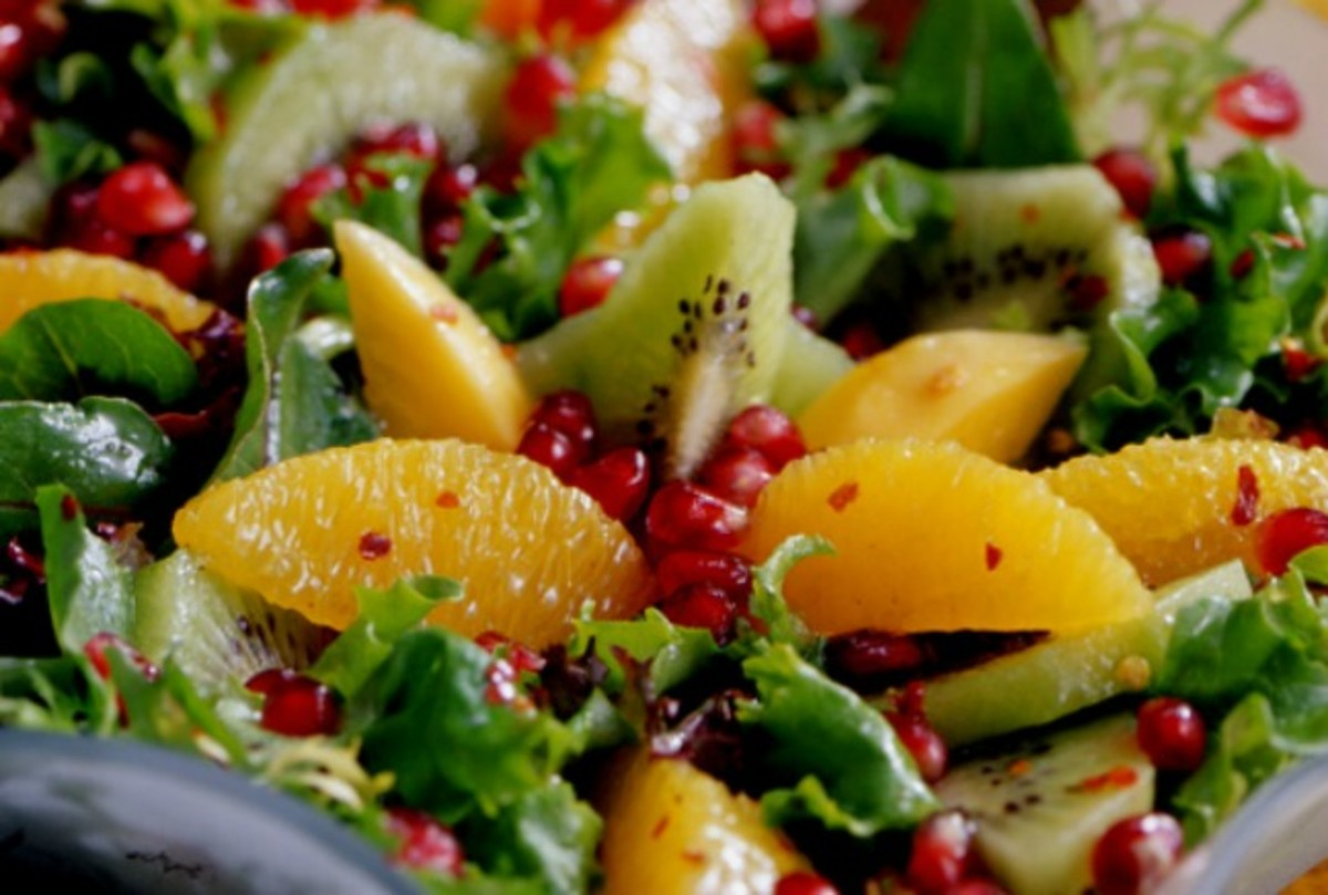 Pomegranate, Orange, Papaya, and Kiwi Green Salad