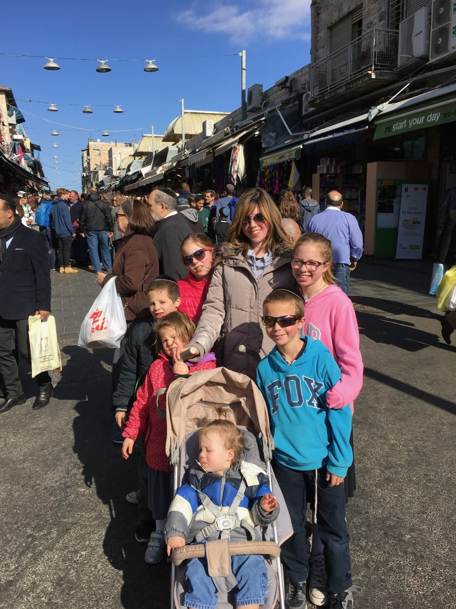 Jamie geller and the family at the shuk