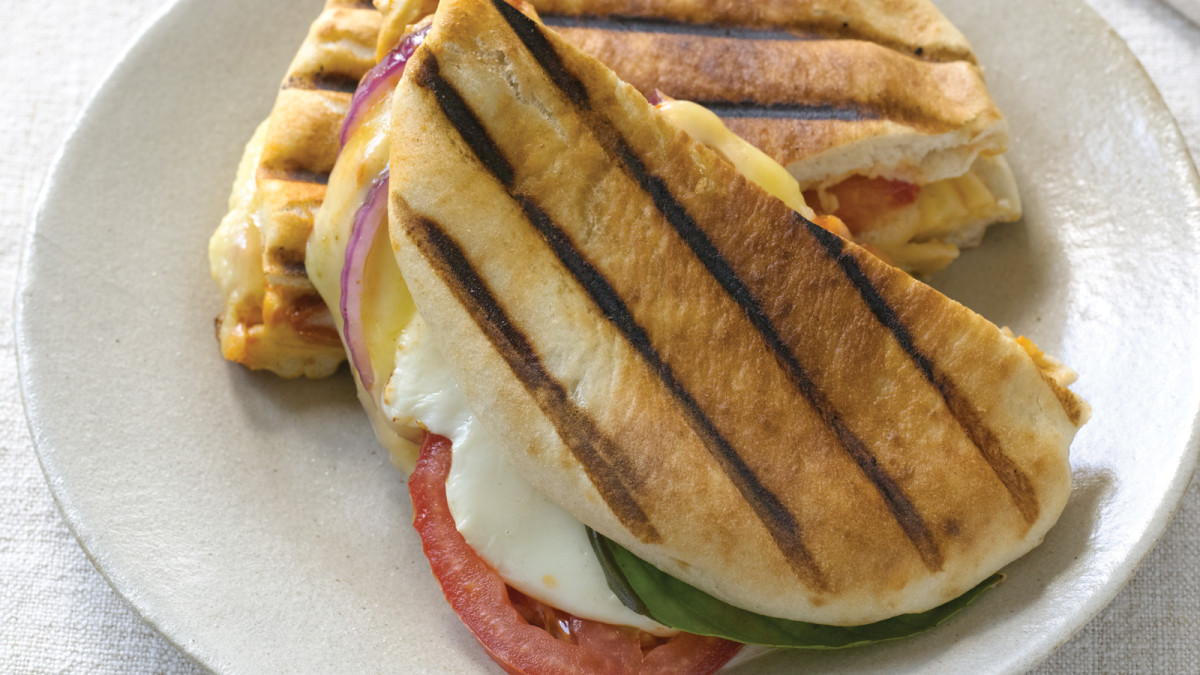 three cheese pita panini with basil, red onion and tomatoes