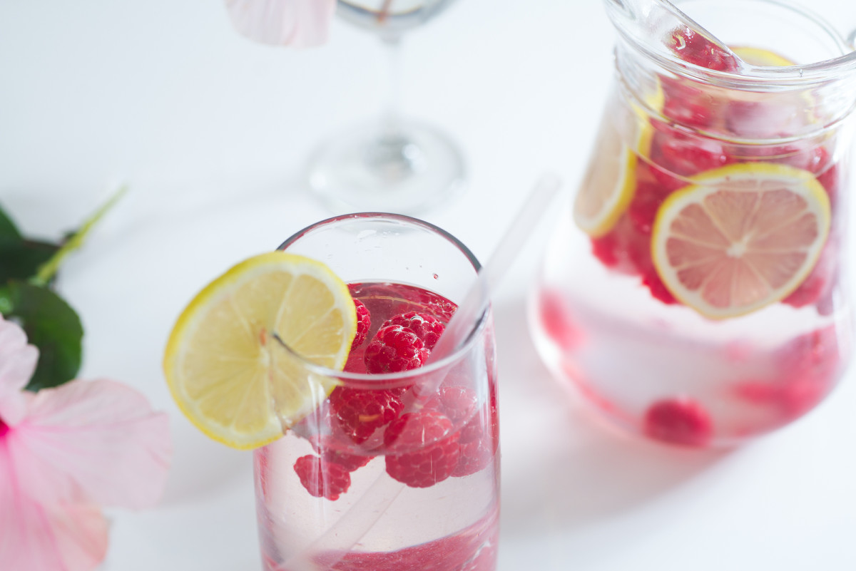 Fresh lemonade with raspberry ice cubes