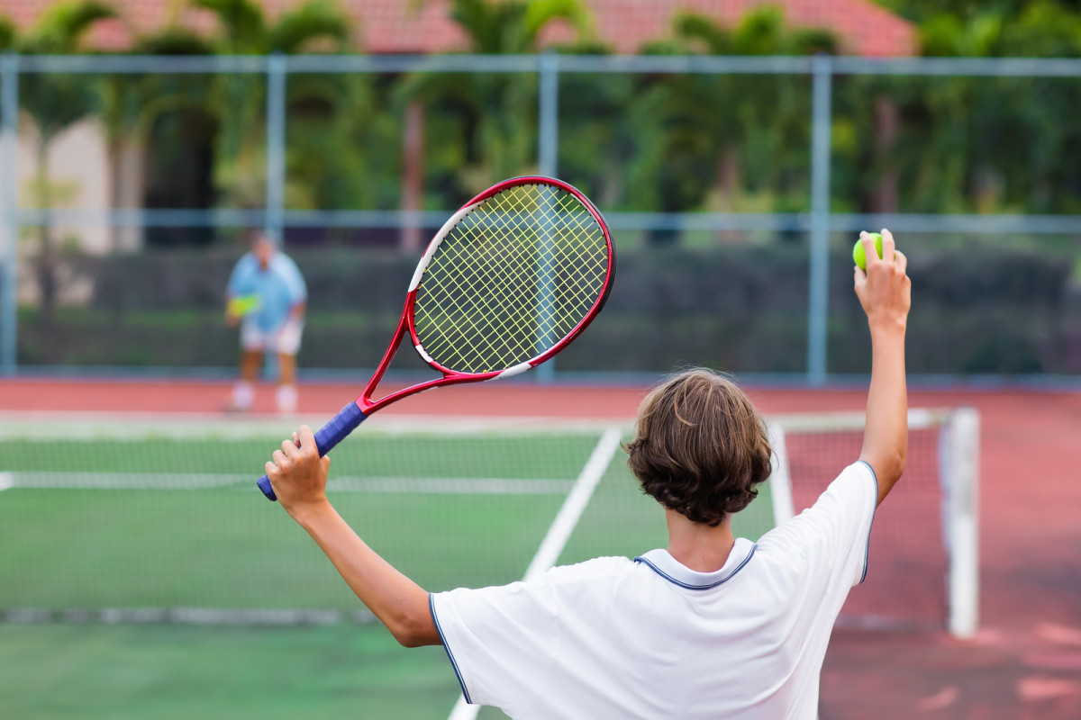 bigstock-Child-Playing-Tennis-On-Outdoo-204207586