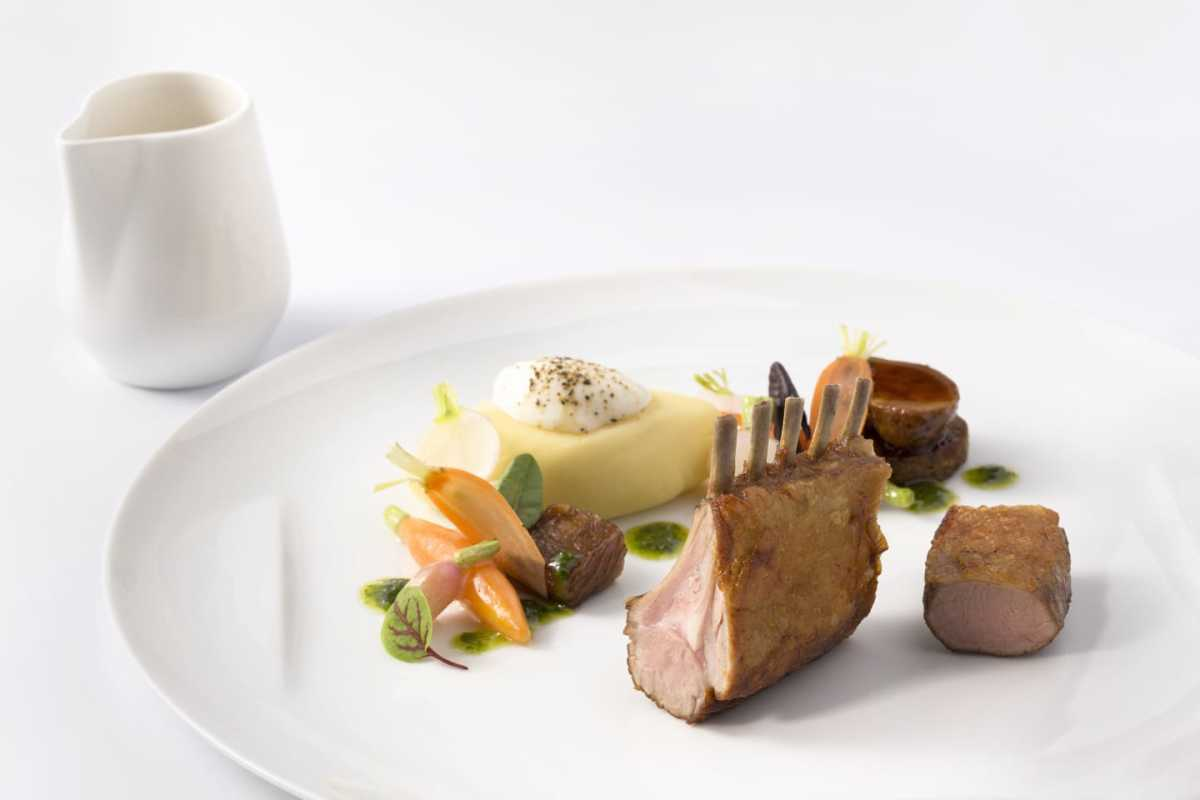 ROASTED LAMB RIBS SERVED WITH RATTE POTATO CREAM AND ROOT VEGETABLES WITH STAR ANISE AROMA, IN A RED WINE JUS