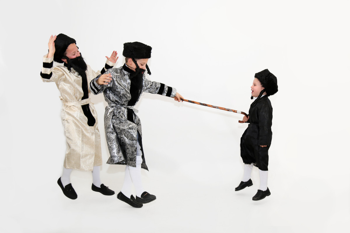 3 Boys Dressed as Chasidim Dancing with a Cane
