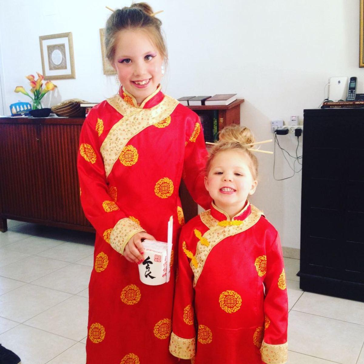 GIRLS IN ASIAN COSTUME